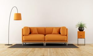 Modern living room with white wall orange couch and floor lamp - 3d rendering